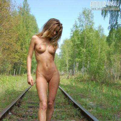 Beautiful teen girl naked outside at the railway