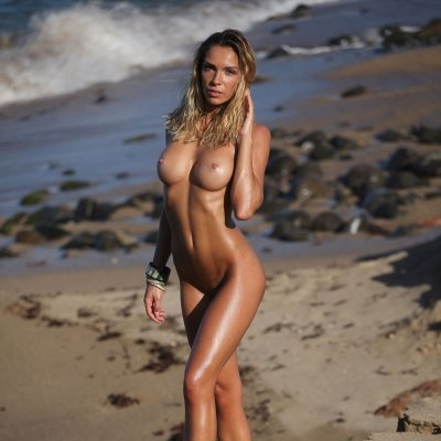 Perfect nude body of totally natural girl at the beach