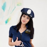 Pretty teenager girl undressing her police suit and showing skin