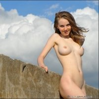 Teen girl Lidiya bare on a Fortress