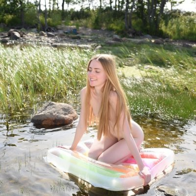 Gorgeous teenager girl Malinka playing nude with water outdoors in the sun
